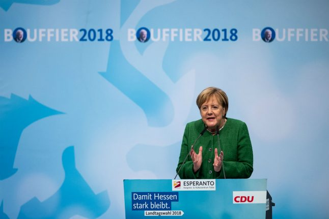 Merkel on the spot after painful vote in Hesse
