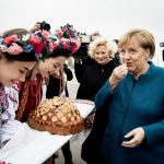 As Merkel travels abroad, can she still hold power as a world leader?
