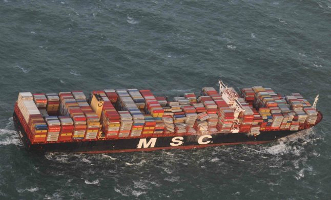 Ship loses cargo in storm, as clean up begins after flooding in northern Germany