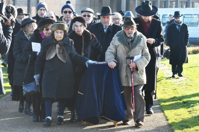 Holocaust victims killed at Auschwitz laid to rest in Britain