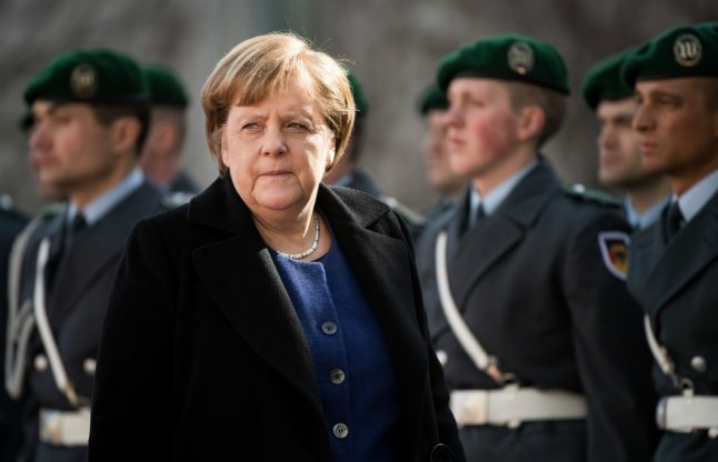 Merkel expresses 'regret' over May's Brexit defeat amid fears of no-deal