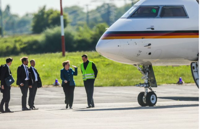 Merkel's plane damaged as 'over-excited' fan causes runway accident