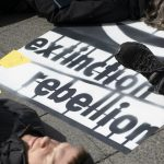 Extinction Rebellion protesters chain themselves to Merkel's chancellery