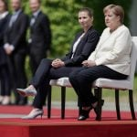 'I take care of my health': Merkel sits through official ceremony after trembling spells