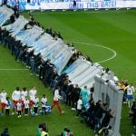 Berlin football fans knock over mock-up wall before match