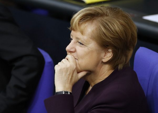 Rocky road ahead for Merkel after ally loses shock vote