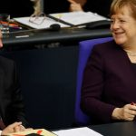 Bumps ahead for Merkel after ally loses shock vote