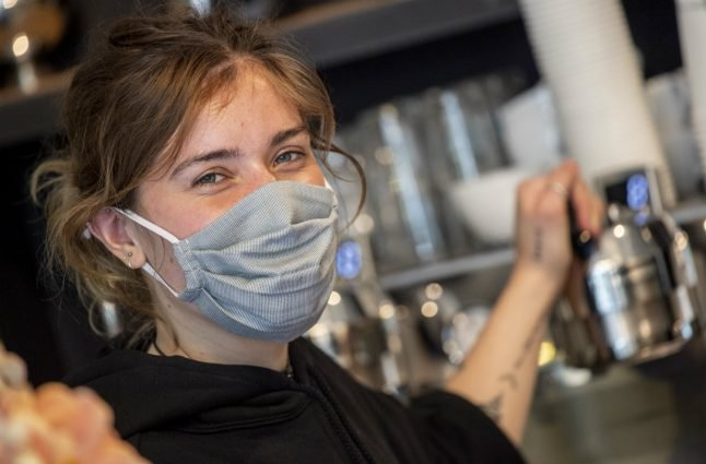 'It's warm and you can't breathe well': Germans don face masks to slow coronavirus spread