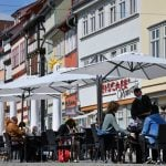 First German state ends coronavirus social distancing requirements