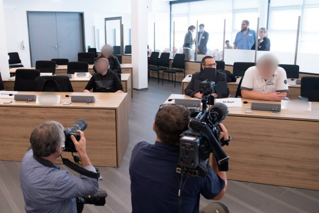Alleged anti-refugee militants go on trial in Germany