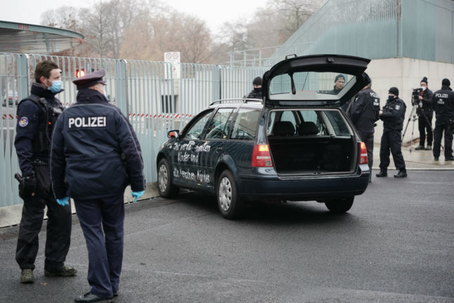 Man held after car driven into German chancellery gates