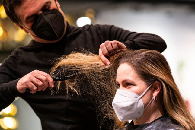 Germany's hairdressers reopen after months of shutdown