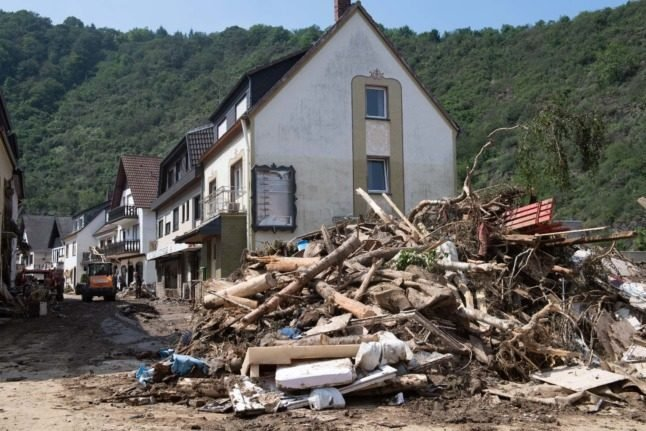 Merkel demands faster climate action as German flood death toll rises
