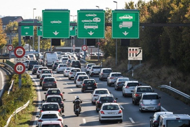 Cross-border workers commute by car but they can for now continue to work at home