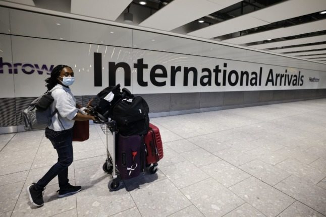 Travellers from Europe to England face fewer Covid tests as UK eases border rules