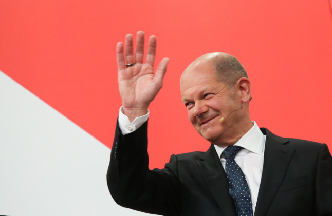 AS IT HAPPENED: Social Democrats narrowly win German election as CDU suffers historic losses