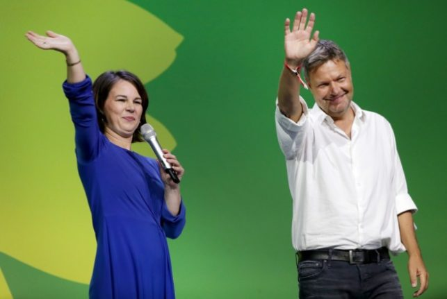 Annalena Baerbock and Robert Habeck, co-leaders of the Greens, wave to supporters at the Greens election party on Sunday after the election.
