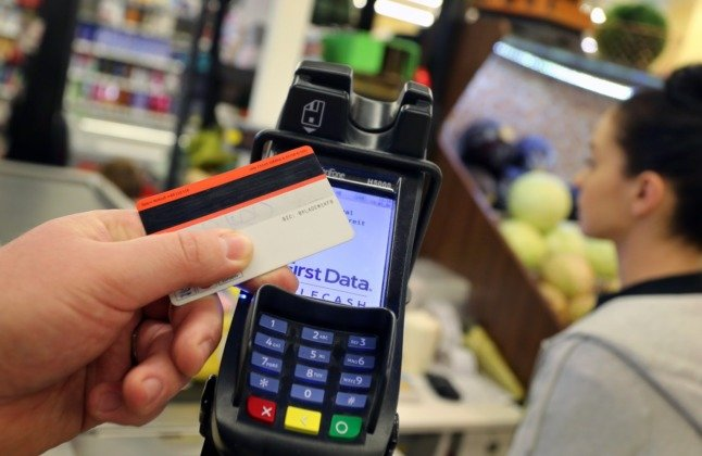 A person paying for shopping with a card.