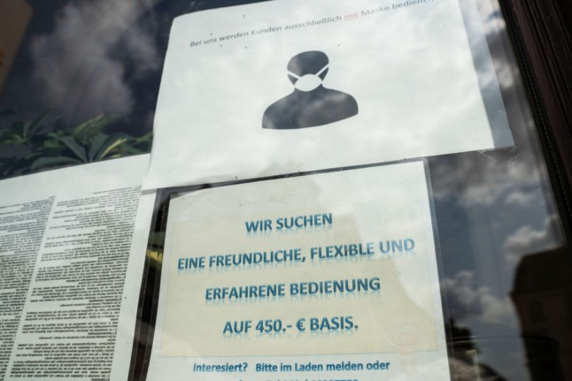 A sign looking for people to work 'mini-jobs' in Frankfurt.