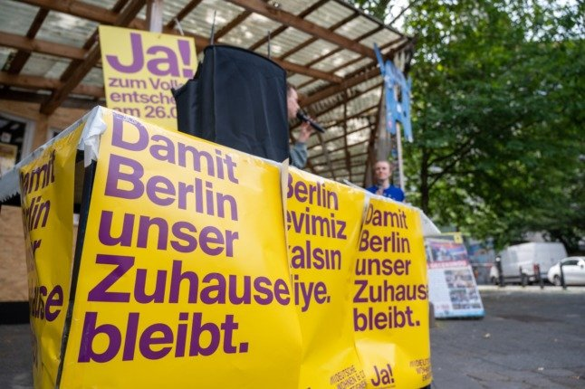 Posters by campaigners for Berlin's referendum to bring houses from large landlords into public ownership.