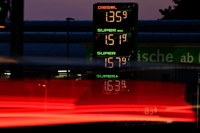 A car drives past a petrol station in Berlin.