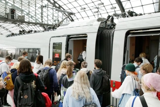 Travellers board a train at Berlin Central Station in September 2021.