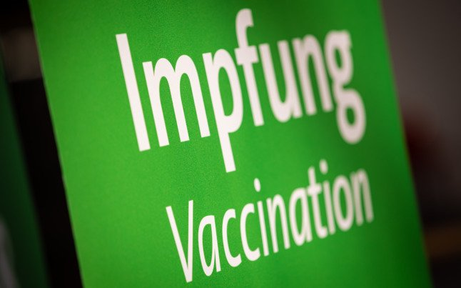 A sign shows the way to vaccinations at the Hanover vaccination centre.