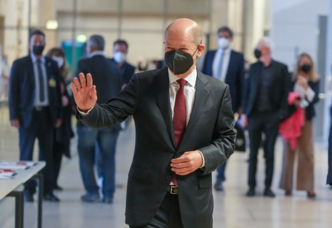 SPD chancellor candidate Olaf Scholz walks in the Bundestag after the German election.