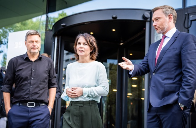 The Greens co-leaders Annalena Baerbock and Robert Habeck with FDP leader Christian Lindner on the right after talks on Friday.