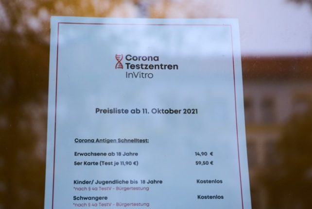 A sign shows the costs of Covid-19 rapid tests at a test centre in Berlin