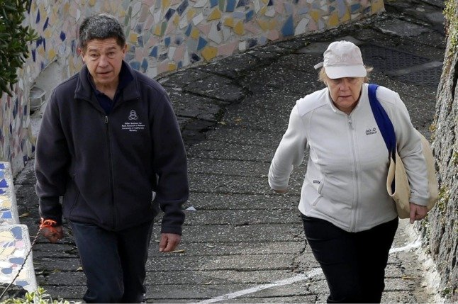 German Chancellor Angela Merkel and her husband Joachim Sauer enjoy a walk in Sant'Angelo on the Ischia island, near Naples, Italy, in April 2015.